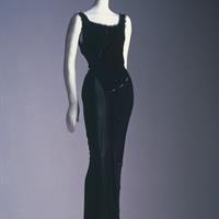 Gown by Cuban-American designer Isabel Toledo (b. 1961, career in New York), 1998 long dress of black rayon jersey, eyelash fringe, and net