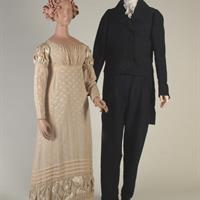 Left: Light pink figured silk crêpe de chine gown and beige figured silk sandal shoes, 1824 Right: Navy homespun wool morning coat and narrow drop-front Cossack trousers, ca. 1827-1828, made by Rachel Donelson Robards Jackson