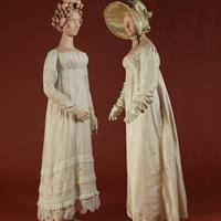 Left: White sprigged muslin gown, ca. 1802-1807, collection of the Ohio Historical Society, Columbus, OH Right: Ivory silk taffeta gown, 1817,  worn by Anne Catherine Spurck of Chillicothe, OH, for her marriage to Earl Dittoe of Somerset, OH, on July 4, 1817;  ivory figured silk bonnet, ca. 1800-1820,  Collection of the Ohio Historical Society, Columbus, OH; ivory kid slip-on shoes with yellow silk tassels, ca. 1800-1820, collection of  The Ohio State University Historic Costume & Textiles Collection, Columbus, OH