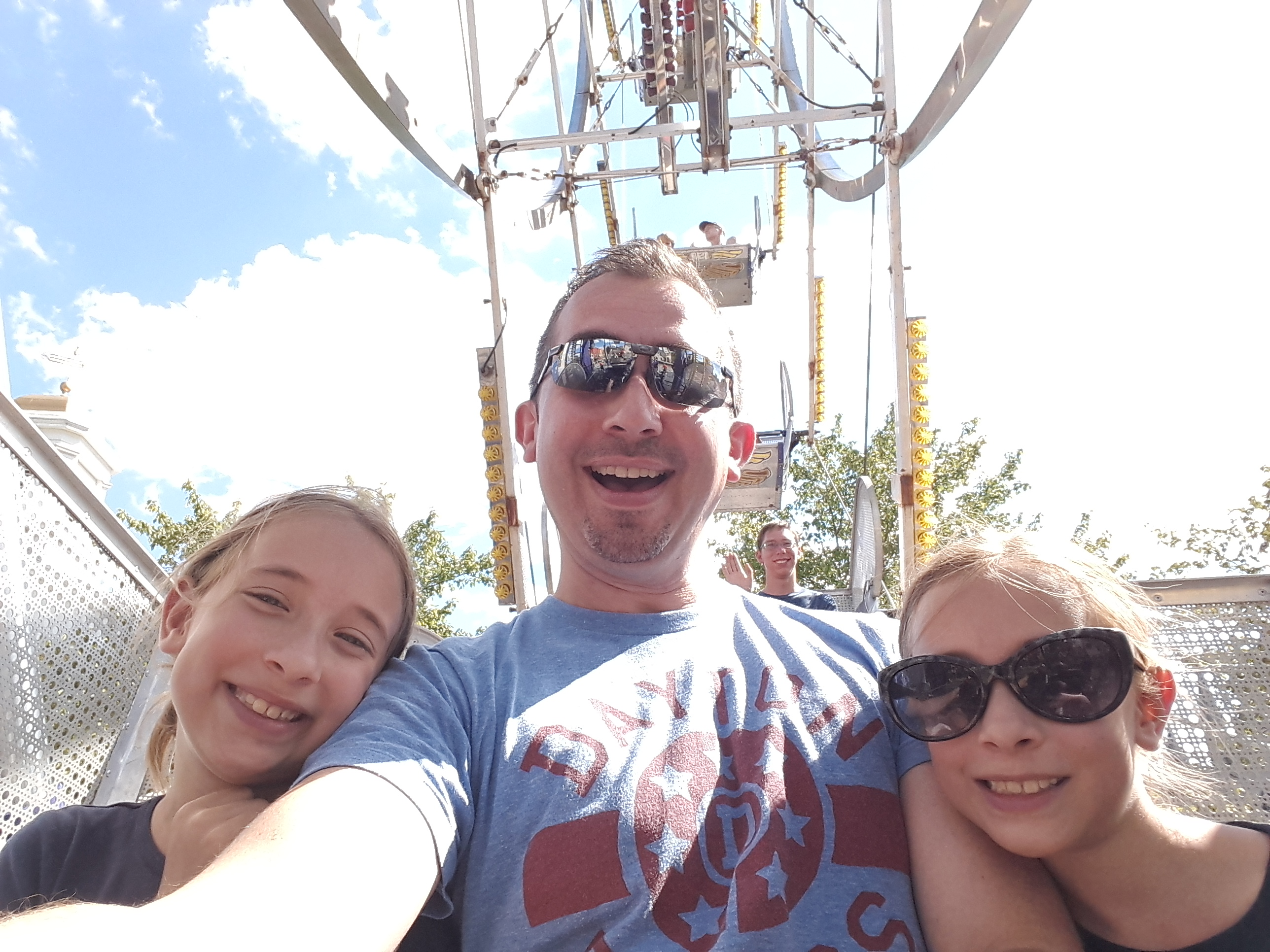 Dan Katona and his daughters on a ferris wheel