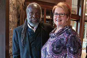 Ohio Arts Council Executive Director Donna S. Collins and artist Omar Shaheed at the opening reception for the fall Spotlight: Featured Artists at the Ohio Governor's Residence exhibition.