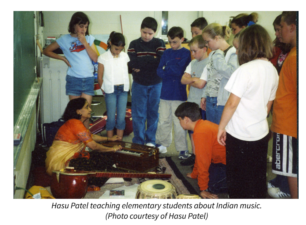 Hasu Patel teaching elementary students about Indian music. Photo courtesy of Hasu Patel