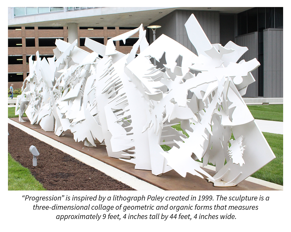 """Progression"" is inspired by a lithograph Paley created in 1999. The sculpture is a three-dimensional collage of geometric and organic forms that measures  approximately 9 feet, 4 inches tall by 44 feet, 4 inches wide."