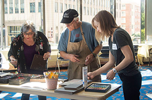 Visitors to the Ohio Arts Council's Riffe Gallery participate in an artmaking workshop with Doreen St. John