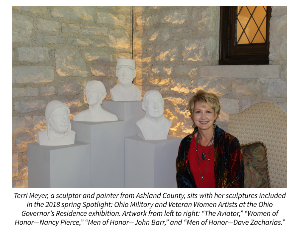 Terri Meyer, a sculptor and painter from Ashland County, sits with her sculptures included in the 2018 spring Spotlight: Ohio Military and Veteran Women Artists at the Ohio Governor's Residence exhibition. Artwork from left to right: