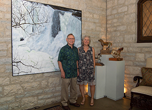 Artists Marty J. Kalb and Valerie Dunning Edwards next to their artwork on view at the Spotlight: Featured Artists at the Governor's Residence exhibition